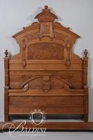Early Victorian Carved Bed with Burl Panels and Arch Top Design