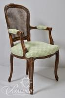 Cane Back Upholstered Arm Chair