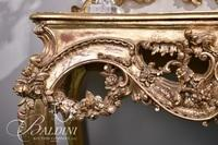 Heavily Carved Rococo Console Table with Foliate Carvings and Gilded Gold Finish