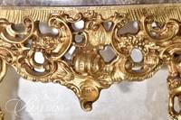 Marble Top Gold Gilt Heavily Carved Console Table with Cherub Pedestals and Winged Dragon Centerpiece