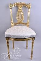 Upholstered Lyre Back Slipper Chair with Brass Studs Around Seat Bottom