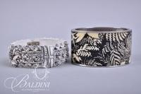 (2) Hinged Cuff Bracelets and (2) Stretch Bracelets with Black and Gold Coloring