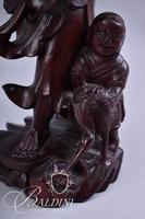 Carved Asian Man Carrying Fish and Child Figure at His Feet