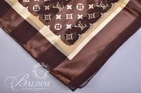 Harve Benard and Designer Scarf Believed to be Louis Vuitton