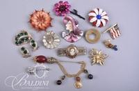 Assorted Brooches Including Flowers, Female Figures, Cameo and More