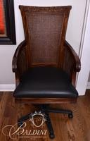 Heavily Carved Office Chair with Cane Back and Leather Seat on Swivel Base