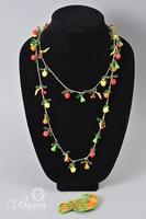 Necklace with Enameled Fruit and Brooches