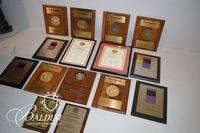 "Various Awards and Plaques for ""The Wild Boar"" Restaurant"
