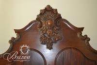 Heavily Carved Victorian Style Bed with Medallion Accent